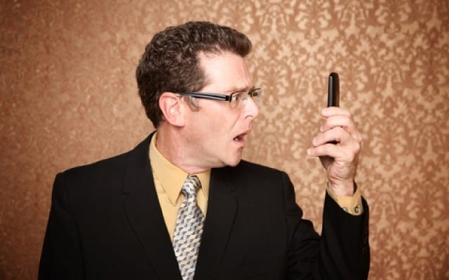 shutterstock-businessman-looking-phone_story