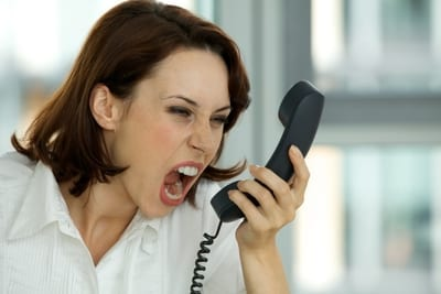 Angry-Lady-Screaming-into-Phone-1669365